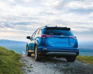 toyota-2018-rav4-hybrid-limited-electric-storm-blue-rear-l
